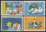 Нидерланды 1983 год. Детские рисунки: дети и Рождество, 4 марки