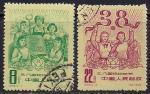 Китай. КНР 1964 год. Международный женский день. 2 гашеные марки